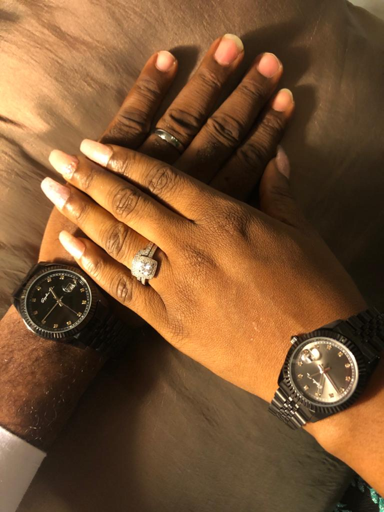 Picture of couple with their ring and watch