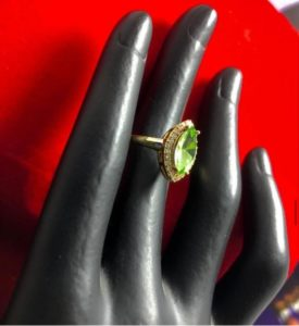 A green/emerald engagement ring used for marriage, proposals and as a fashion piece
