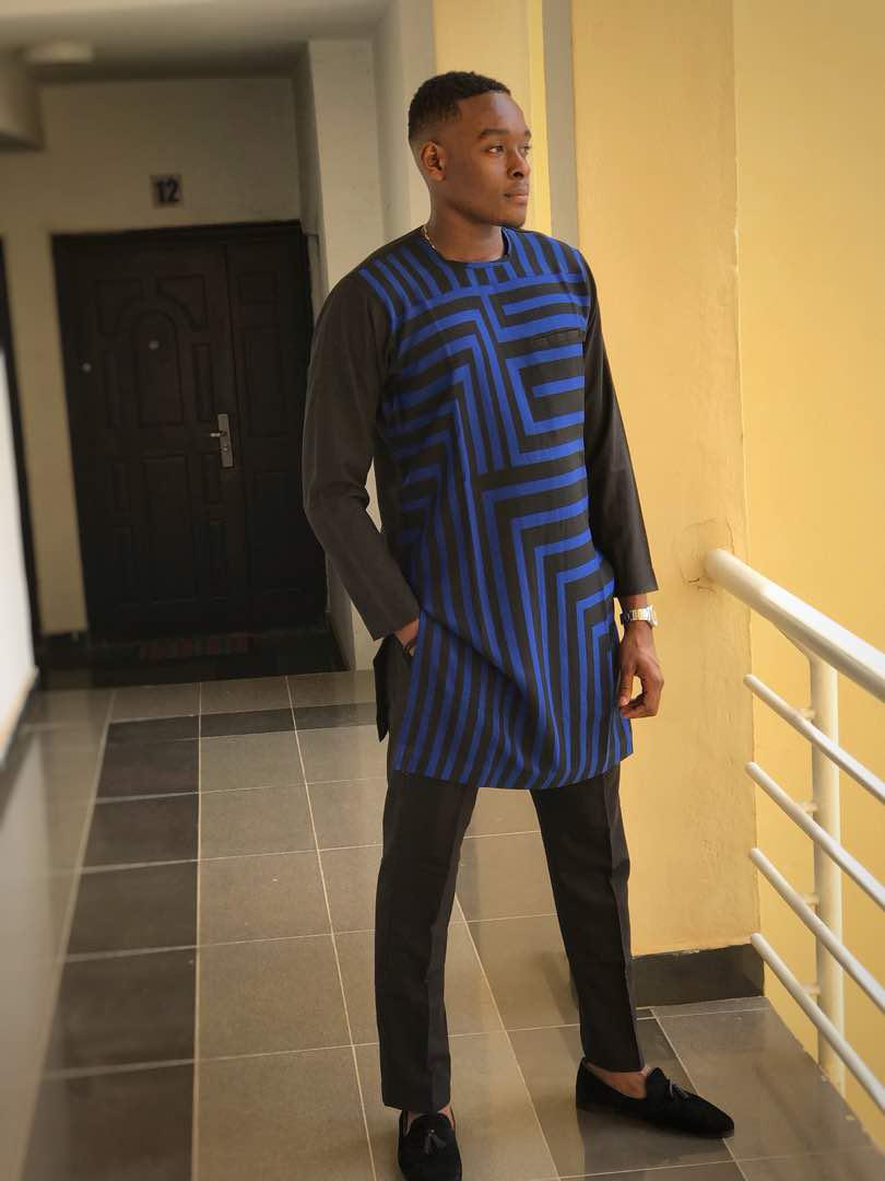 A Black long sleeved Kaftan with Blue vertical and Horizontal Patterns in front